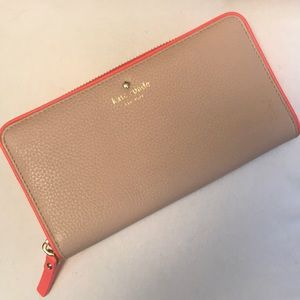 Kate Spade leather taupe wallet with pink trim